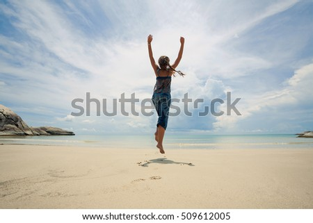 Attractive young woman having fun on wild beach. Winter in tropics concept #509612005
