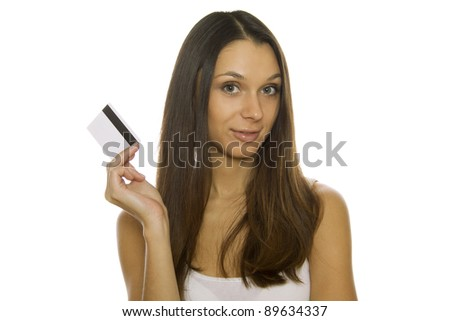 Attractive young woman holding a credit card. Isolated on white background