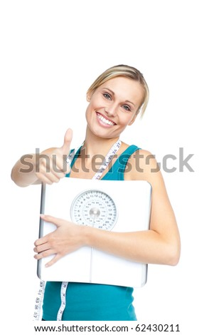 Attractive young woman holding a weight scale looking at the camera over white background - stock photo