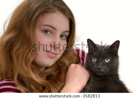 Attractive young woman holding her gray cat, isolated on white