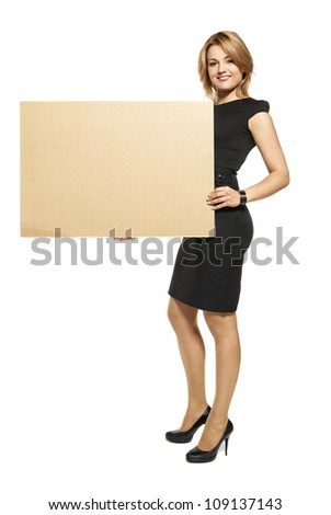 Attractive  Young Woman Holding Up a Blank Paperboard. Studio shot of woman isolated on white background.