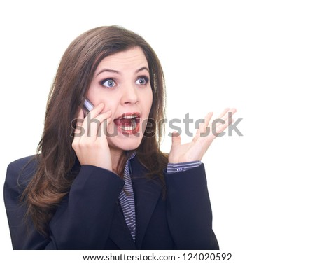Attractive young woman in a black jacket talking on a mobile phone and screams. Isolated on white background