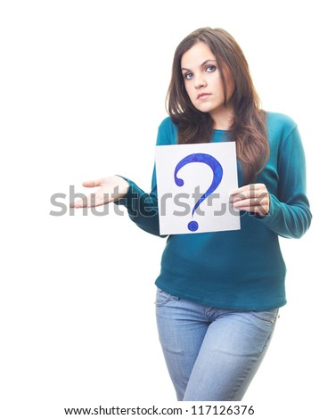 Attractive young woman in a blue shirt holding a poster with a big question mark, and throws up her hands. Isolated on white background