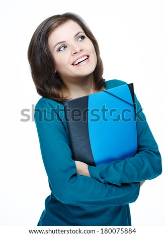 Attractive young woman in a blue shirt. Holding folder and looking to the left. Isolated on white background