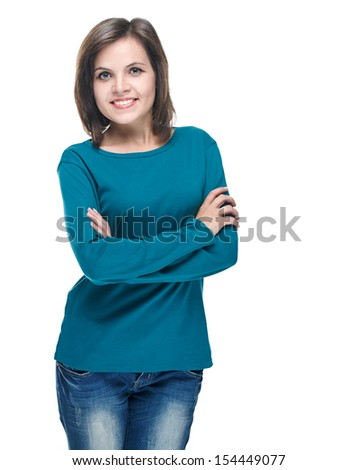 Attractive young woman in a blue shirt. Standing with folded hands. Isolated on white background