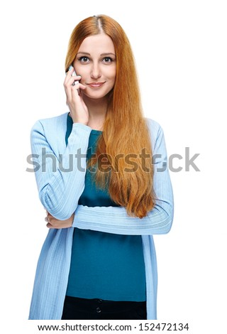 Attractive young woman in a blue shirt. Talking on a mobile phone. Isolated on white background