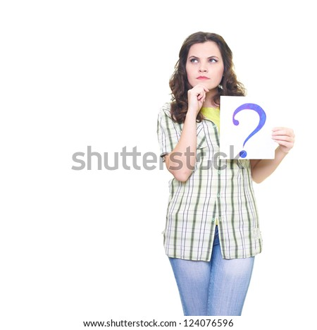Attractive young woman in a checkered shirt holding a poster with a big question mark. Looks into the upper-right corner. Isolated on white background
