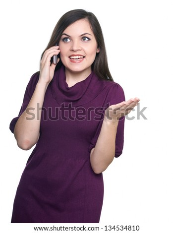Attractive young woman in a dress. Woman talking on a mobile phone. Looking to the right. Isolated on white background