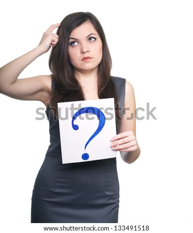 Attractive young woman in a gray business dress. Woman holds a poster with a big question mark. On  a white background