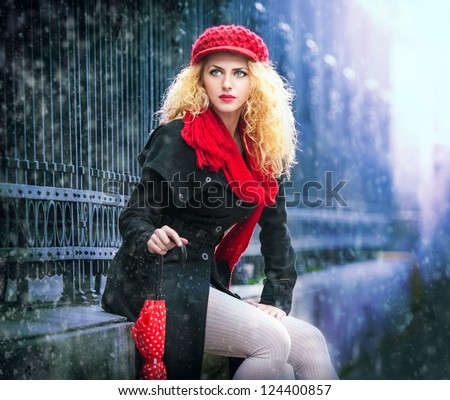 attractive young woman in a winter fashion shot.Winter wild woman on snow.Winter Girl with beautiful make up, and snow flake.Portrait of attractive woman