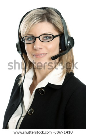 Attractive young woman in business suit wearing a headset isolated on a white background - stock photo
