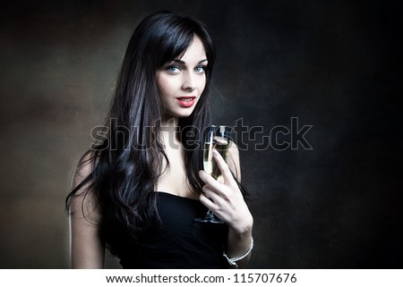 attractive young woman in elegant dress and glass of champagne