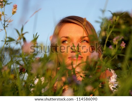 Attractive young Woman in high flower meadow