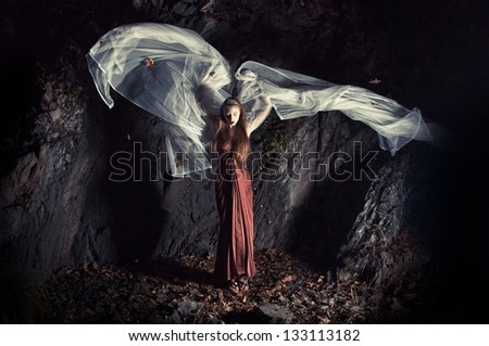 attractive young woman in red dress and white veil, dynamic fashion shot