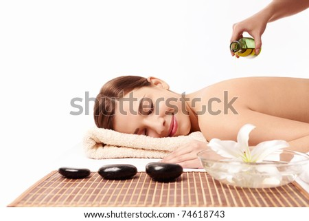 Attractive young woman in spa salon