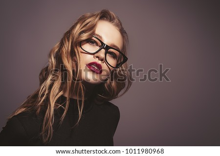 Attractive young woman in spectacles. Studio shot. Beauty, fashion concept. Optics style. #1011980968