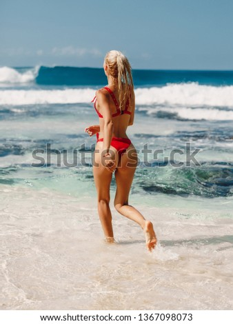 2549bcaf4d Beautiful women with bikini behind the sea. Images and Stock Photos ...