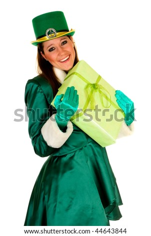 Attractive young woman in traditional St Patrick holiday outfit. Studio shot.