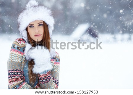 Attractive young woman in wintertime outdoor  #158127953
