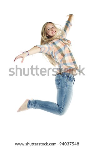 Attractive young woman jumping in the air against white background