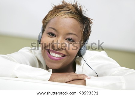 Attractive Young Woman Listening to Headphones - stock photo