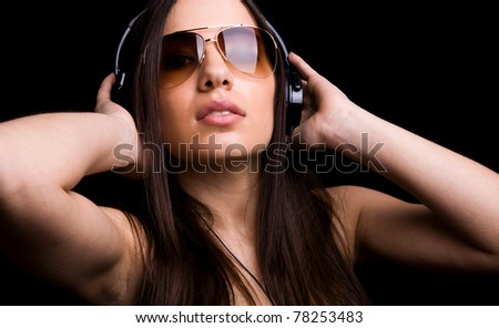 attractive young woman listening to music with headphones