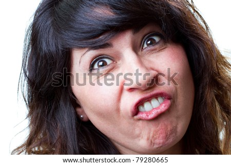 Attractive young woman makes a funny face for the camera