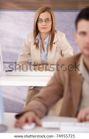 Attractive young woman participating at training course, sitting at table.?