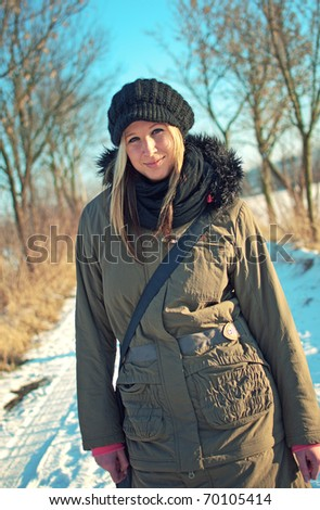 attractive young woman posing in winter park