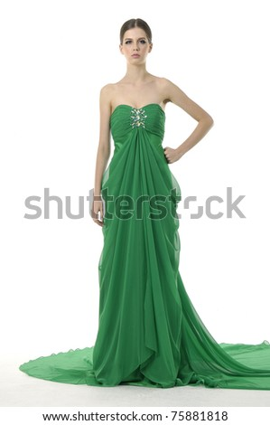 attractive young woman posing on studio wearing green gown