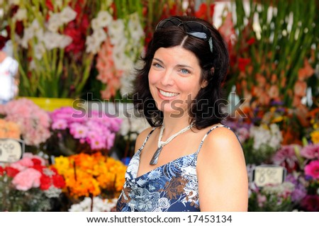 Attractive Young Woman Shopping For Flowers At The Farmers Market