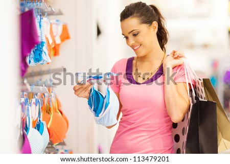 ce930bd69 attractive young woman shopping for underwear in clothing store  113479201