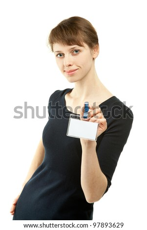 Attractive young woman showing blank badge; studio shot isolated on white