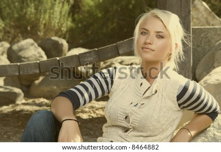 attractive young woman sitting in a park