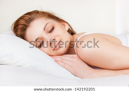 Attractive young woman sleeping in bed