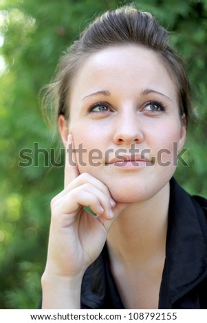 Attractive Young Woman Smiling While Thinking