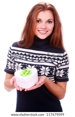 Attractive young woman smiling with gift in hands over a white background