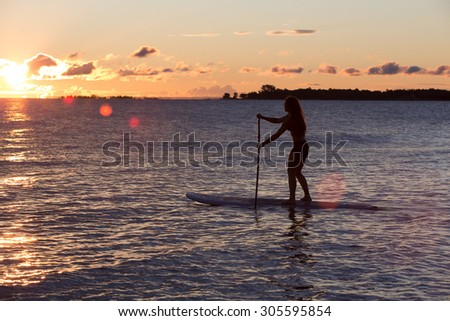 Attractive Young Woman Stand Up Paddle Boarding, Active Beach Lifestyle