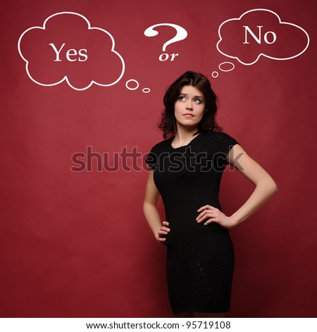 attractive young woman thinking yes or no, studio red background