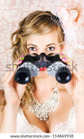 Attractive Young Woman Watching Spring Carnival Horse Races Through Binoculars In A Depiction Of Race Day Fashion