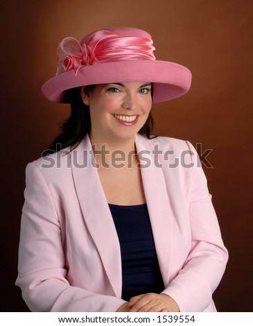 Attractive Young Woman Wearing A Formal Pink Hat