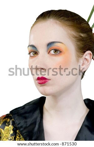 Attractive young woman wearing Asian styled clothes and makeup
