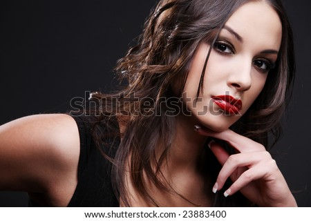 Attractive young woman wearing red lipstick. - stock photo