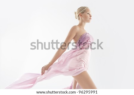 Attractive young woman wearing transparent silk fabric.