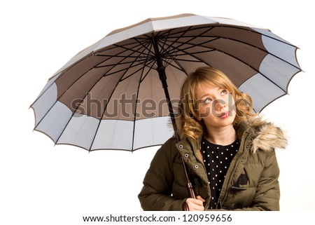 Attractive young woman with an umbrella looking up at the sky watching the weather for rain isolated on white
