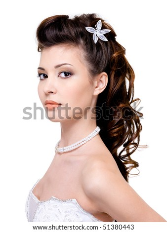 stock photo Attractive young woman with beautiful wedding hairstyle