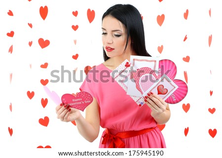Attractive young woman with cards on Valentine Day