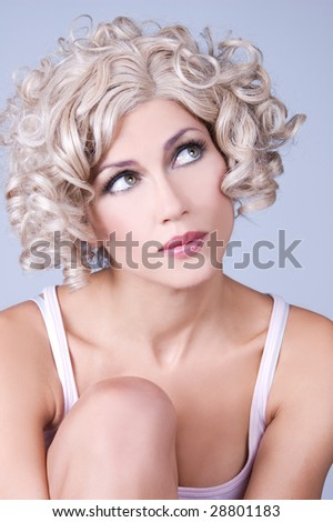 Attractive young woman with curly hair