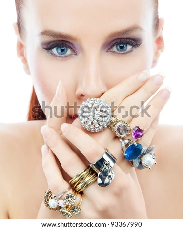 Attractive young woman with diamond on the hands looking to the camera on the white background