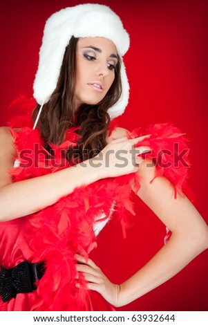attractive young woman with feather and hat posing - stock photo